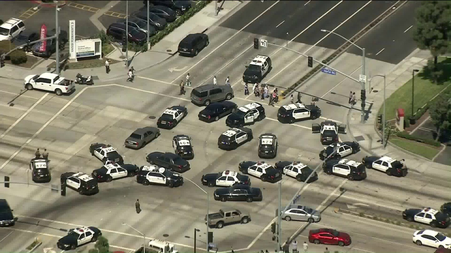 Police vehicles fill the intersection of Bellflower Blvd and Imperial Highway in Downey, where a suspect has been taken into custody after reports of an active shooter at a Kaiser Permanente medical center.