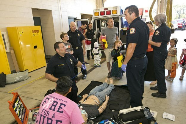 Members of the RSF Fire Department demonstrate emergency support for a heart attack victim during the open house