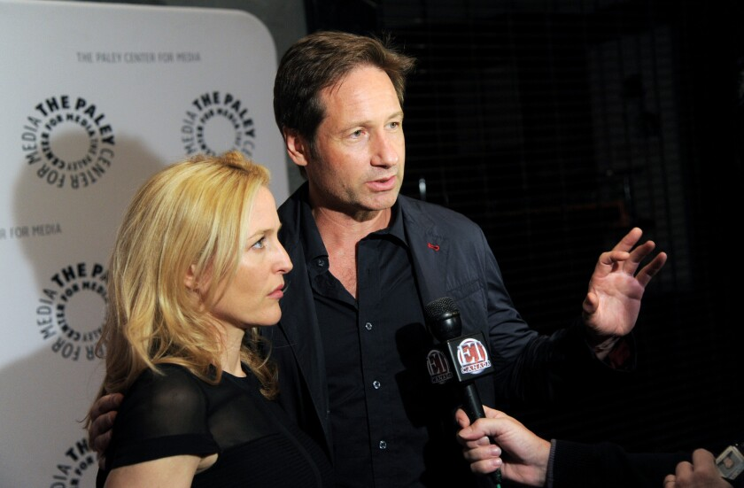 "Gillian Anderson and David Duchovny attend ""The Truth Is Here: David Duchovny and Gillian Anderson on 'The X-Files'"" at the Paley Center for Media in New York."