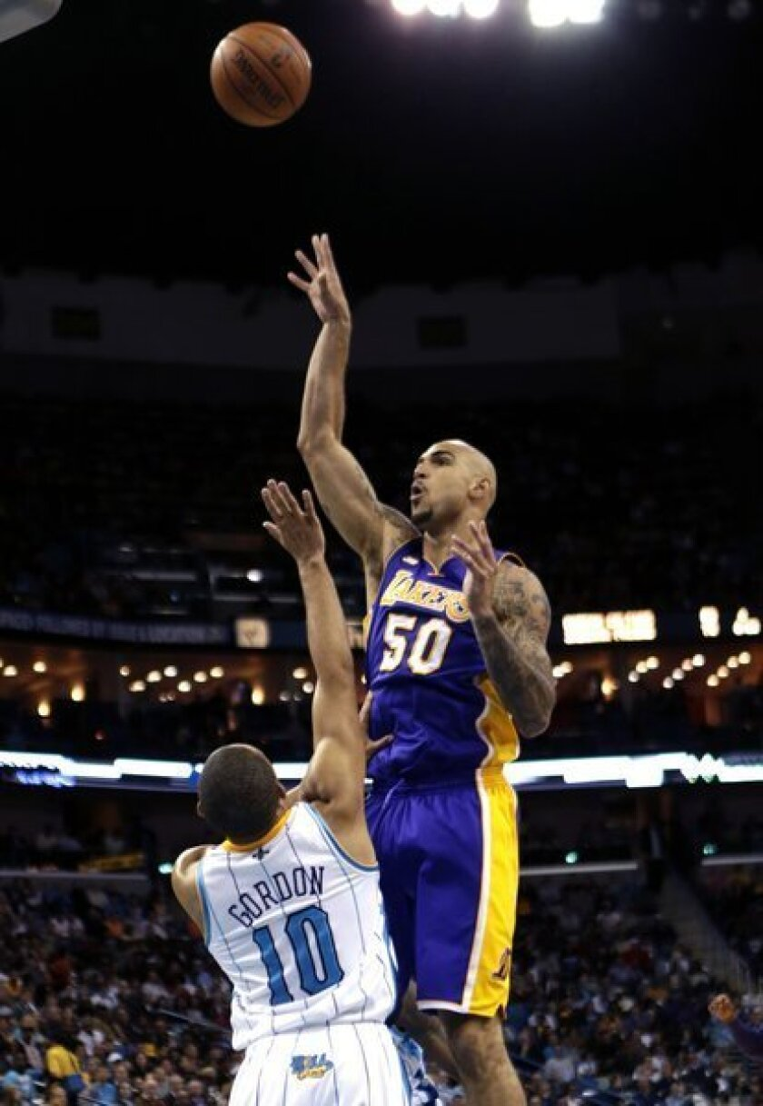 The Lakers extended a qualifying offer to Robert Sacre, making the seven-foot center a restricted free agent this summer.