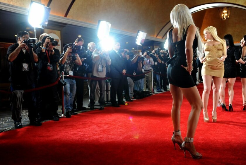 Entertainers pose for photos on the red carpet during the Xbiz adult film awards in Century City earlier this year.