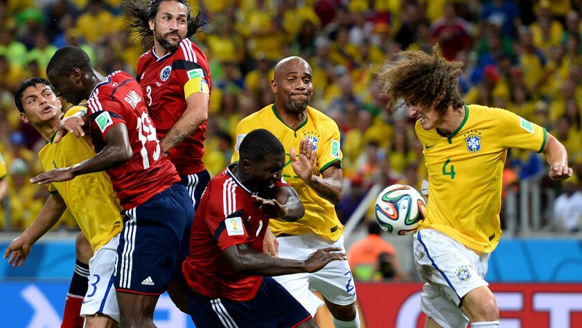 Colombian and Brazilian players battle for the ball during Brazil's World Cup quarterfinal victory Friday. Brazil has committed a tournament-leading 96 fouls heading into Tuesday's semifinal match with Germany.
