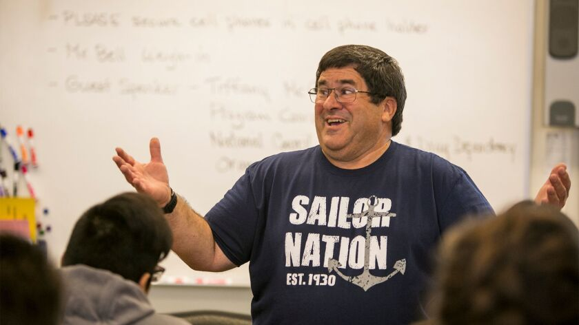 Newport Harbor High School health teacher Ed Bell weighs in during class on December 19, 2017. Bell