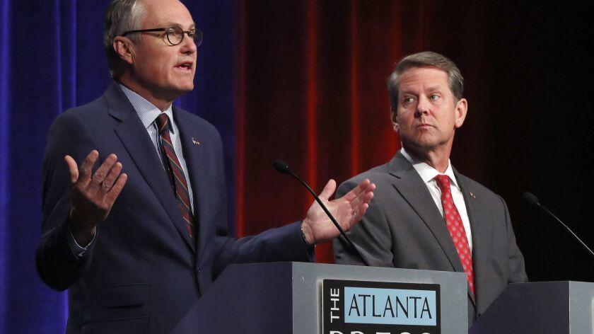 Georgia Lt. Gov. Casey Cagle, left, and Secretary of State Brian Kemp during an Atlanta Press Club debate on July 12.