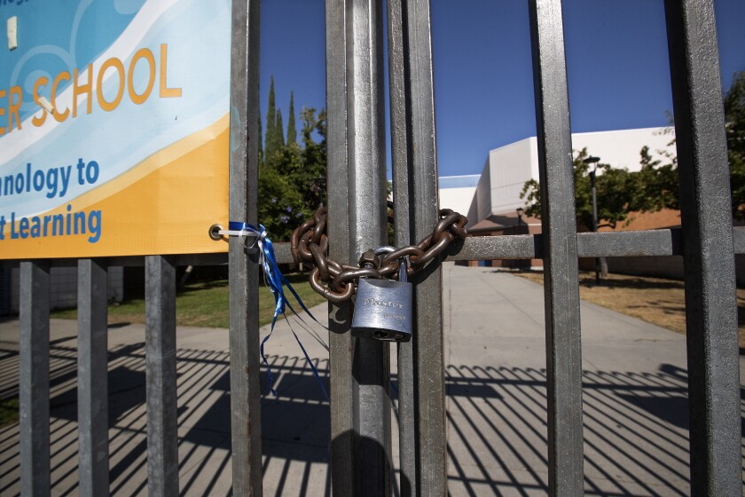 A locked gate in front of Los Angeles High School.
