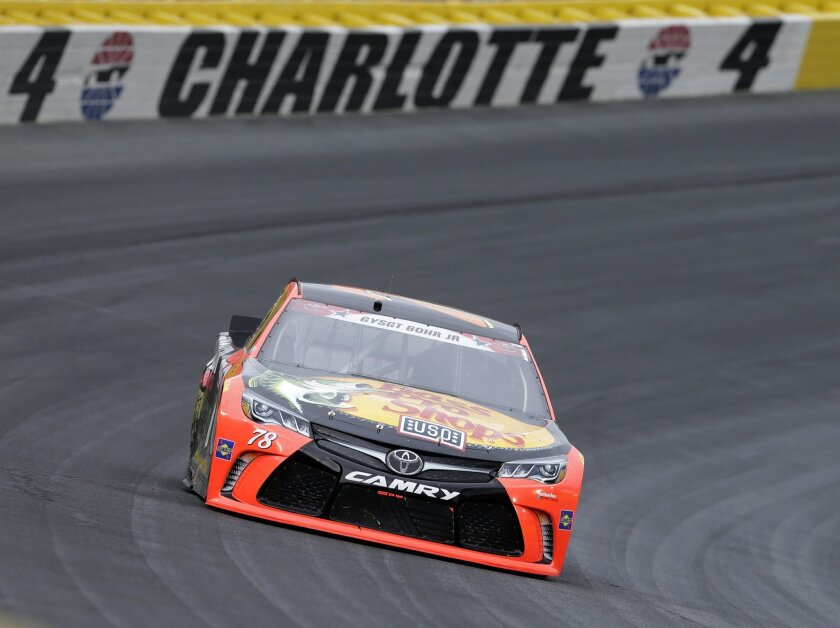 Martin Truex Jr races out of Turn 4 during the NASCAR Sprint Cup series auto race at Charlotte Motor Speedway in Concord, N.C., Sunday, May 29, 2016. (AP Photo/Chuck Burton)