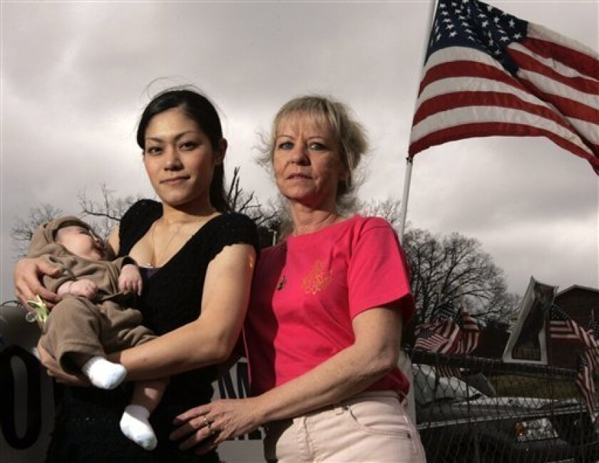 FILE - This March 6, 2009 file photo shows Hotaru Nakama, center, her son, Mickey, and her mother-in-law, Robin Ferschke, right, outside their home in Maryville, Tenn. Nakama married Ferschke's son, Sgt. Michael Ferschke, by phone in 2008 while he was stationed in Iraq and she was in Japan. Sgt. Ferschke died in combat a month later. The House on Wednesday Dec. 15, 2010, approved a private relief bill, meaning it only applies to an individual case, granting permanent resident status to Hotaru Ferschke. (AP Photo/Wade Payne, File)