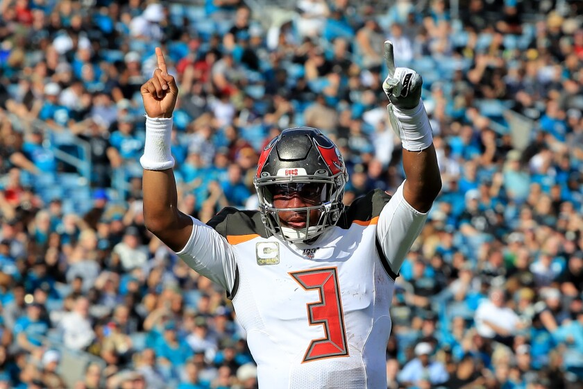 Tampa Bay Buccaneers quarterback Jameis Winston celebrates a touchdown.