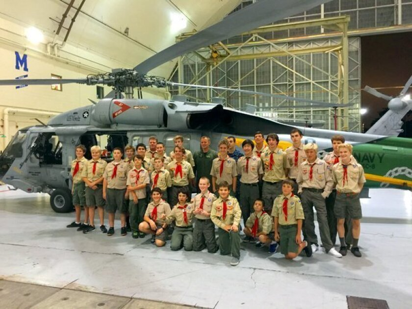 La Jolla Boy Scouts from Troop 4 tour Naval Base Coronado's helicopter facilities in January 2015. FRONT ROW: Theo Couris, Cameron Reikes, Sterling Price, Gabe Punta, Phillipe Covington and Casey Holden. MIDDLE ROW: Nick Holden, Erik Ortlieb, Mitch Coleman, Ryan Finley, Chase Maisel, Charlie Michae