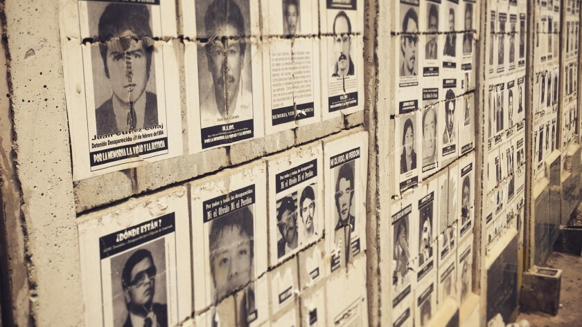 """A wall of photos of the disappeared at La Verbena Cemetery in Guatemala City in the documentary """"Finding Oscar."""""""