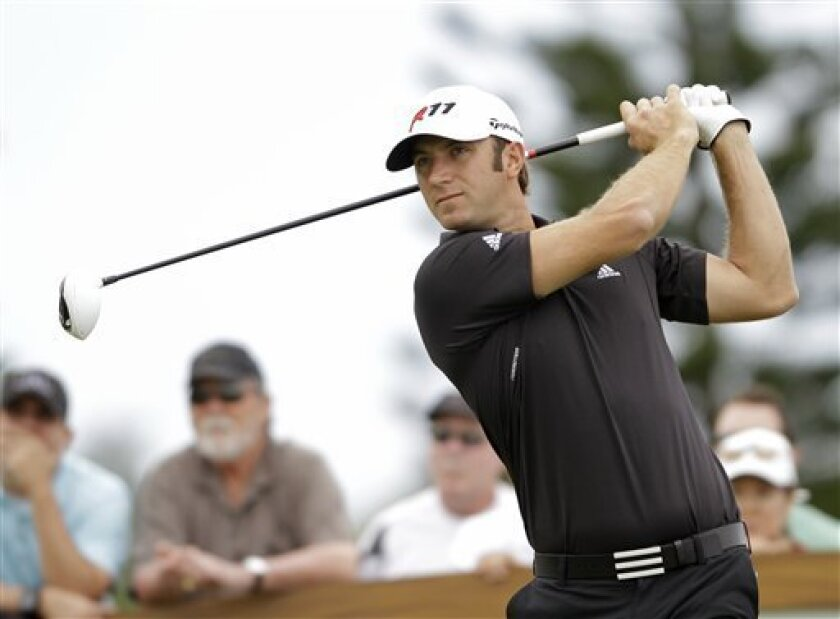 Dustin Johnson follows his drive from the third tee during the second round of the Hyundai Tournament of Champions golf tournament in Kapalua, Hawaii Friday, Jan. 7, 2011. (AP Photo/Eric Risberg)