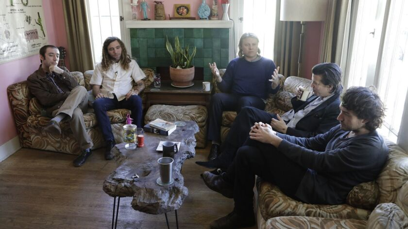 LOS ANGELES, CA - March 12, 2019: Ty Segall, center, speaks during an interview with his band in Seg