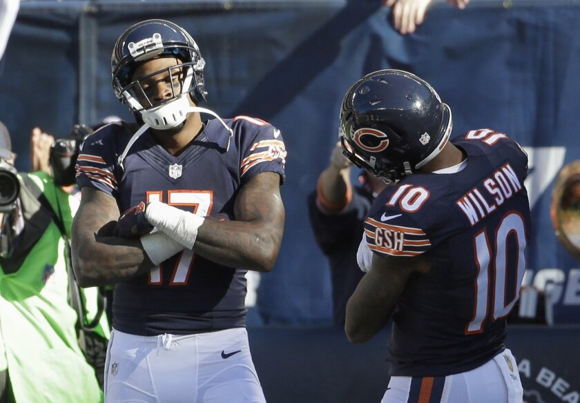 Chicago Bears receiver Alshon Jeffery (17) celebrates his touchdown reception with teammate Marquess Wilson (10) during the first half of an NFL football game against the Minnesota Vikings, Sunday, Nov. 1, 2015, in Chicago. (AP Photo/Nam Y. Huh)