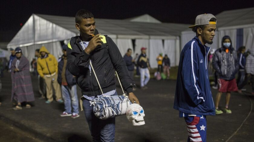 A Central American migrant prepares to leave the temporary shelter in the Jesus Martinez stadium, in