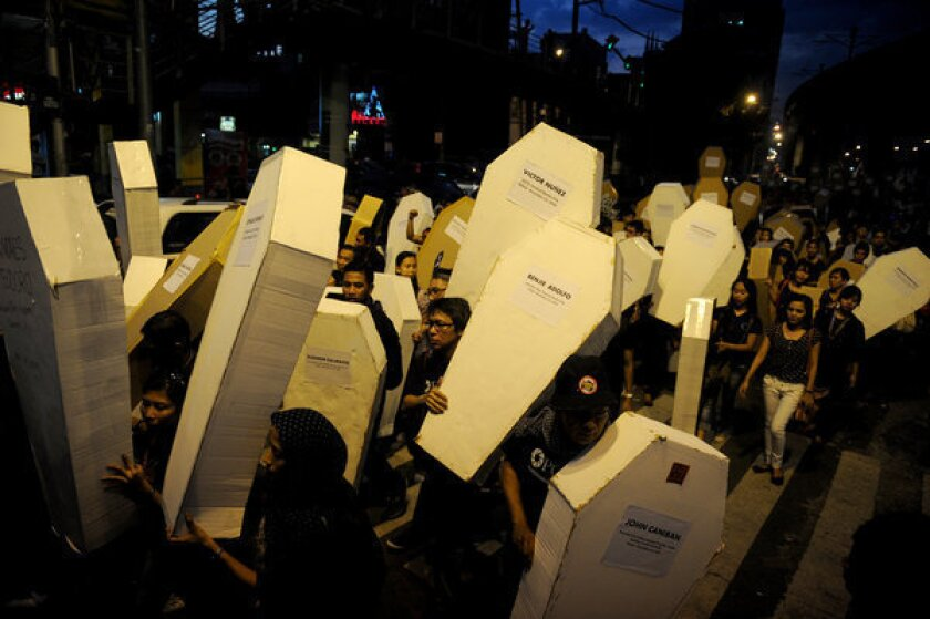 Philippines protesters demand justice as massacre trials lag