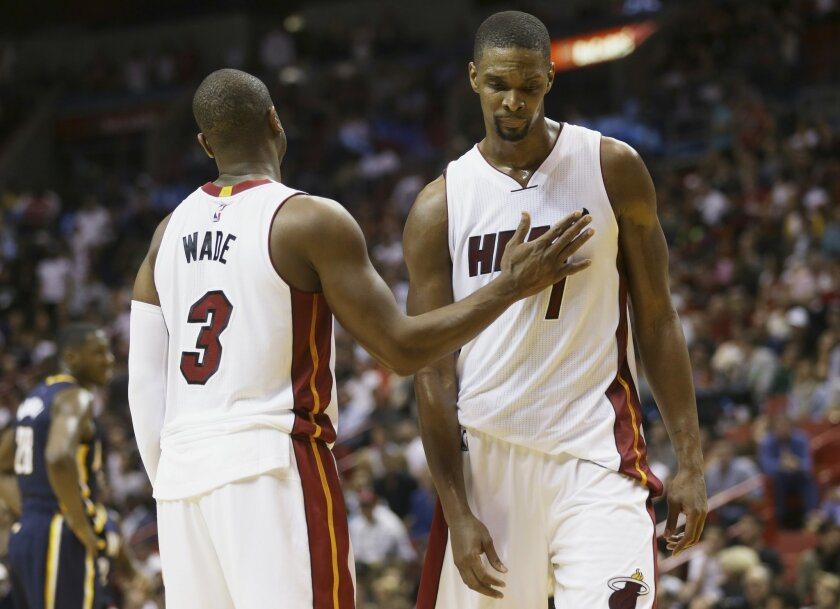 In this Monday, Jan. 4, 2016, photo, Miami Heat's Dwyane Wade (3) pats Chris Bosh (1) on the chest during the second half of an NBA basketball game against the Indiana Pacers in Miami. A person with knowledge of the situation said Monday, Feb. 15, Bosh is dealing with another blood-clot scare and w