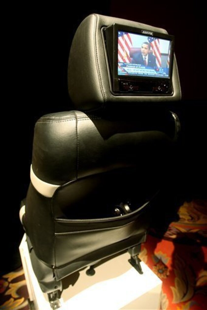 The Audiovox FLO/TV seatback television system is pictured following a news conference during media day at the International Consumer Electronics Show (CES), Wednesday, Jan. 7, 2009 in Las Vegas. (AP Photo/Isaac Brekken)