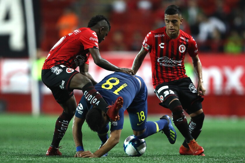 Argentine midfielder Leonel Miranda (right), shown here with Miller Bolanos (left) and Boca Junior's Frank Fabra in a preseason exhibition July 10, is one of several new players for the Tijuana Xolos.
