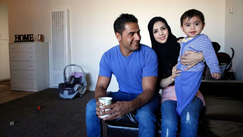 Sher Mohammed Haidari, his wife Tamana Haidari and their son Ahmad, 8 months, at their El Cajon apartment earlier this month.