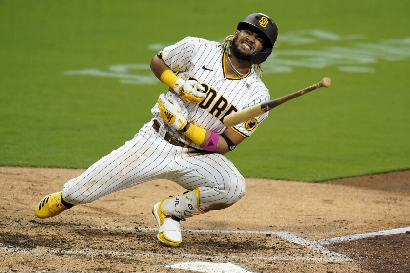San Diego Padres' Fernando Tatis Jr. reacts after being hit by a pitch while batting during the seventh inning of a baseball game against the Colorado Rockies, Monday, Sept. 7, 2020, in San Diego. (AP Photo/Gregory Bull)