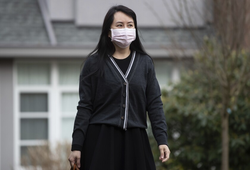Meng Wanzhou, chief financial officer of Huawei, leaves her home to attend B.C. Supreme Court, in Vancouver, on Thursday, March 4, 2021. (Darryl Dyck/The Canadian Press via AP)