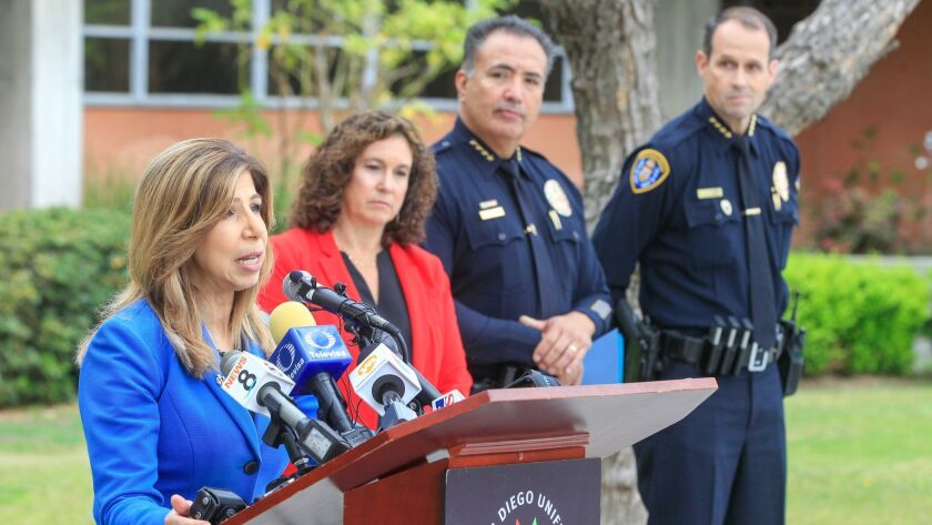 District Attorney Summer Stephan speaks to the media about school safety along with (from left) San Diego Unified School District Superintendent Cindy Marten, school district police Chief Mike Marquez and SDPD Chief David Nisleit on Friday at school headquarters in San Diego.