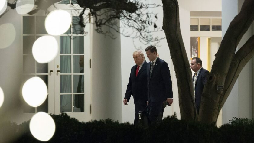 A second Trump staffer has resigned this week after abuse allegations surfaced. Speechwriter David Sorensen denies the allegations. Staff secretary Rob Porter, center, resigned Wednesday.