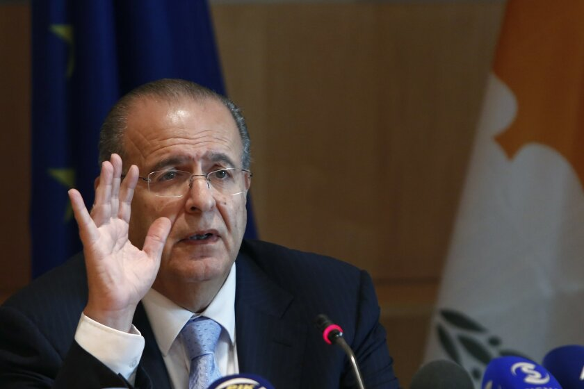 Cyprus Foreign Minister Ioannis Kasoulides speaks to the media at the foreign house in divided capital of Nicosia, Monday, Oct. 6, 2014. Cyprus' foreign minister says Turkey's stated intention to search for oil and gas in waters where the ethnically-split island nation has licensed an Italian-South Korean consortium to drill could upset reunification talks. (AP Photo/Petros Karadjias)