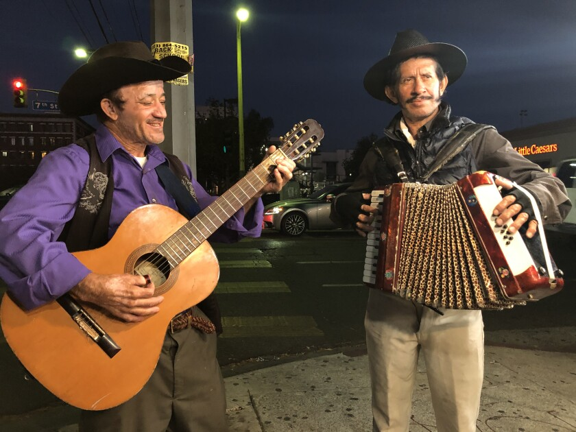 Elías Flores and César Villanueva perform at the corner of Union and 7th Street.