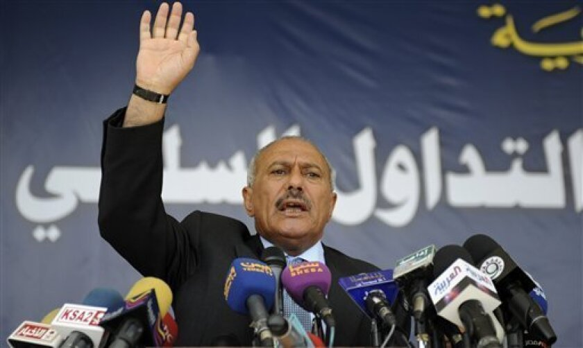 FILE - In this March 10, 2011 file photo, Yemeni President Ali Abdullah Saleh, speaks to supporters during a gathering in a soccer stadium in Sanaa, Yemen. A Human Rights Watch report released Wednesday, Feb. 8, 2012 said Saleh ordered a crackdown on Arab Spring protesters that killed at least 120 people in just one city. (AP Photo/Hani Mohammed, File)