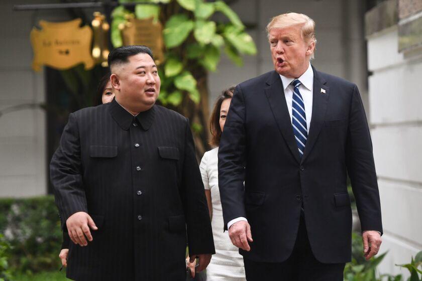 President Donald Trump walks with North Korea's leader Kim Jong Un