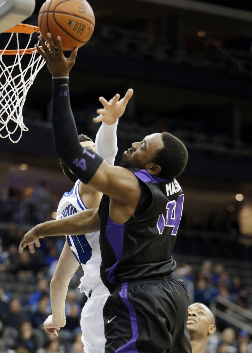 FILE - In this Nov. 9, 2013. file photo, Niagara guard Antoine Mason, right, goes up for a shot against Seton Hall center Aaron Geramipoor during an NCAA college basketball game in Newark, N.J. Mason is the son of former New York Knicks power forward Anthony Mason, yet plays a vastly different game than his pops. While Anthony was one of the most intimidating players in the NBA during his 14 seasons, Antoine is a 6-foot-3 guard who uses his quickness and ability to drive in either direction to get into the lane. (AP Photo/Julio Cortez, File)