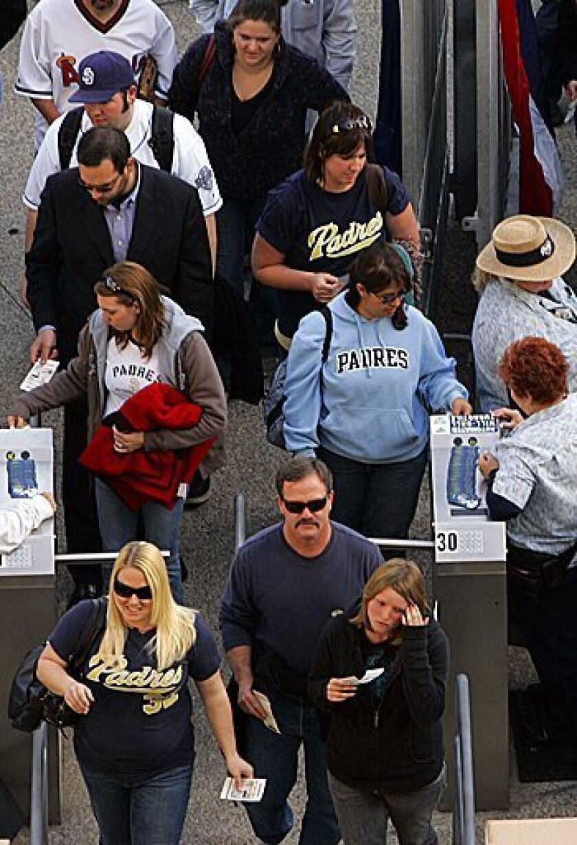 Fans make their way through the turnstiles at Petco Park to see the Padres play the Houston Astros on opening day. K.C. Alfred / The San Diego Union-Tribune