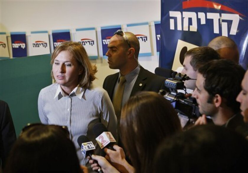 Israeli Foreign Minister and Kadima party leader Tzipi Livni talks to reporters after casting her vote in primaries for the party's list in Tel Aviv, Wednesday, Dec. 17, 2008. Members of Israel's ruling Kadima party are heading to the polls to elect their list of candidates for upcoming national elections. (AP Photo/Dan Balilty)