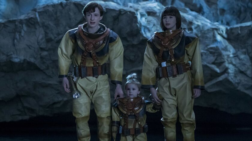"""The Baudelaire children — Louis Hynes as Klaus, Presley Smith as Sunny and Malina Weissman as Violet — in the """"Grim Grotto"""" segment of Netflix's """"A Series of Unfortunate Events."""""""