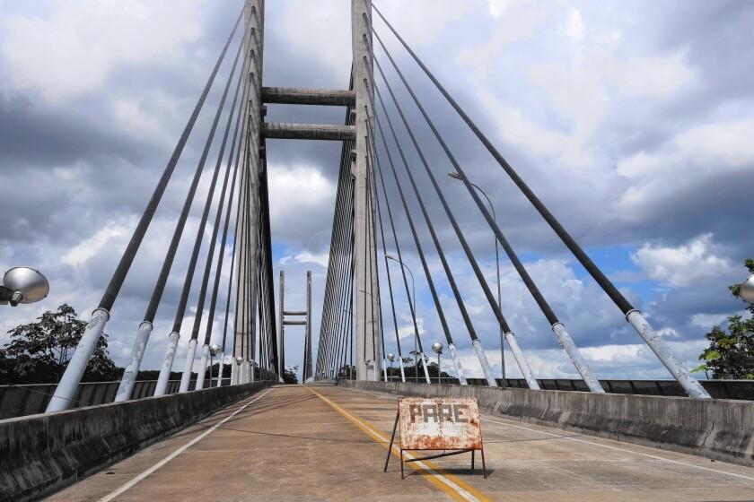 A mammoth suspension bridge in the Amazon connects Brazil and French Guiana, but remains off-limits to travelers and commuters.