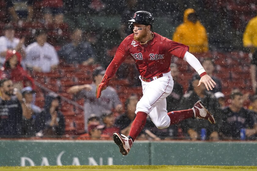 Boston Red Sox's Alex Verdugo runs home to score on a single by Xander Bogaerts during the fifth inning of the team's baseball game against the Kansas City Royals at Fenway Park, Wednesday, June 30, 2021, in Boston. (AP Photo/Elise Amendola)