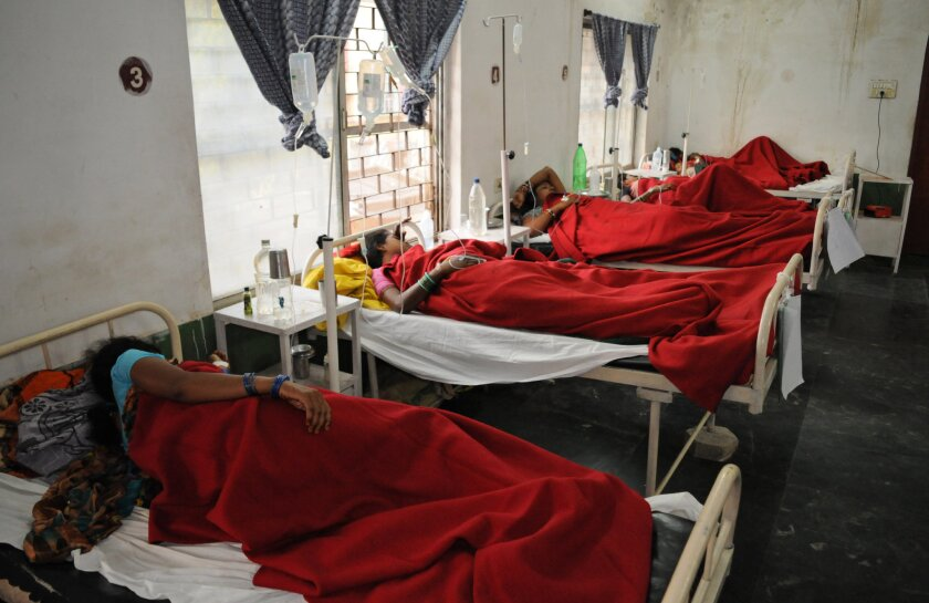 Indian women who underwent sterilization surgeries receive treatment at the District Hospital in Bilaspur, in the central Indian state of Chhattisgarh, on Nov. 12.