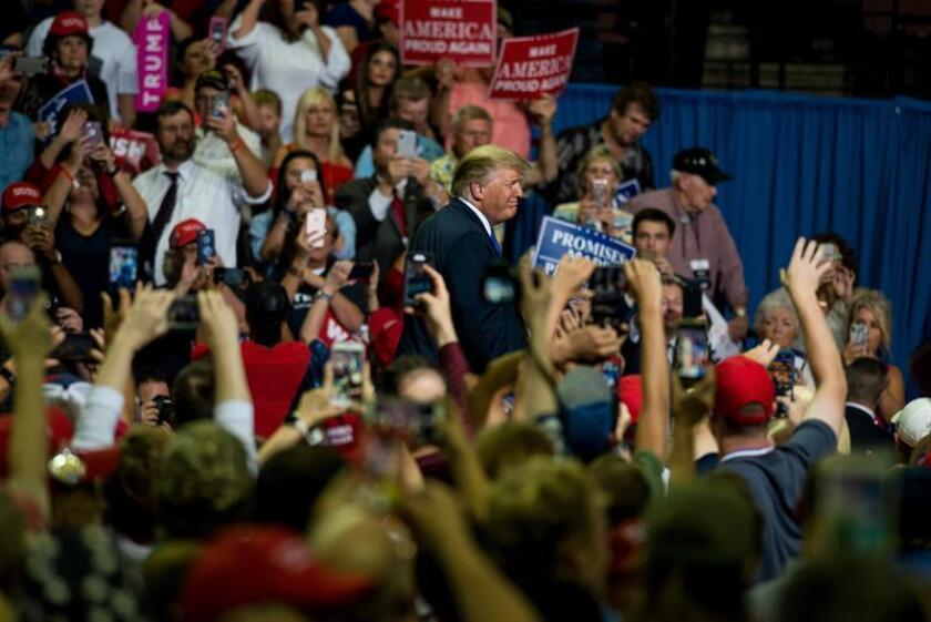 """US President Donald J. Trump (C) participates in a """"Make America Great Again"""" rally on Oct. 2, 2018, at the Landers Center in Southaven, Mississippi. EPA-EFE FILE/Brandon Dill"""