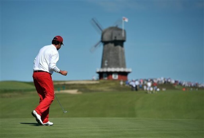 Nathan Smith of the United States team reacts after he sinks a putt on the 15th green during the Walker Cup Match golf tournament held at the National Golf Links of America on Saturday, Sept. 7, 2013 in Southampton, N.Y.(AP Photo/Kathy Kmonicek)