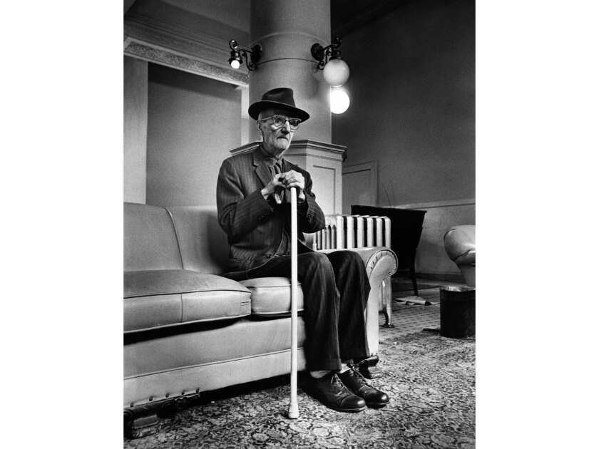 March 16, 1972: Leo Altoonian, 85, waits in lobby of fire damaged Barclay Hotel for his turn to get