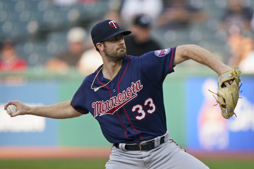 Minnesota Twins starting pitcher John Gant delivers in the first inning of the team's baseball game against the Cleveland Indians, Tuesday, Sept. 7, 2021, in Cleveland. (AP Photo/Tony Dejak)