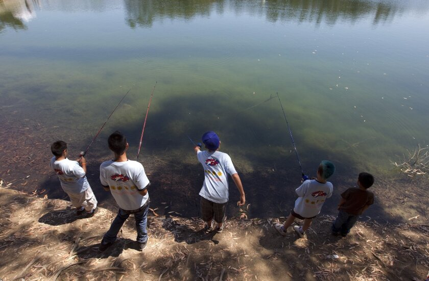 Kids fish during a fishing derby at Chollas Lake [U-T file/Earnie Grafton]
