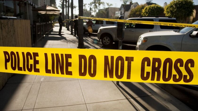 Police tape blocks the sidewalk on Park Place in Coronado down the street from where four people were found dead at about 2:30 a. m. Sunday morning at a condominium. It is not known the circumstance