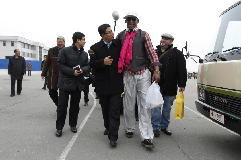 AP10ThingsToSee - Former NBA basketball star Dennis Rodman, second right, walks with North Korea's Sports Ministry Vice Minister Son Kwang Ho, third right, upon his arrival at the international airport in Pyongyang, North Korea, Monday, Jan. 6, 2014. Rodman took a team of former NBA players on a trip for an exhibition game on Kim Jong Un's birthday, Wednesday, Jan. 8. (AP Photo/Kim Kwang Hyon, File)