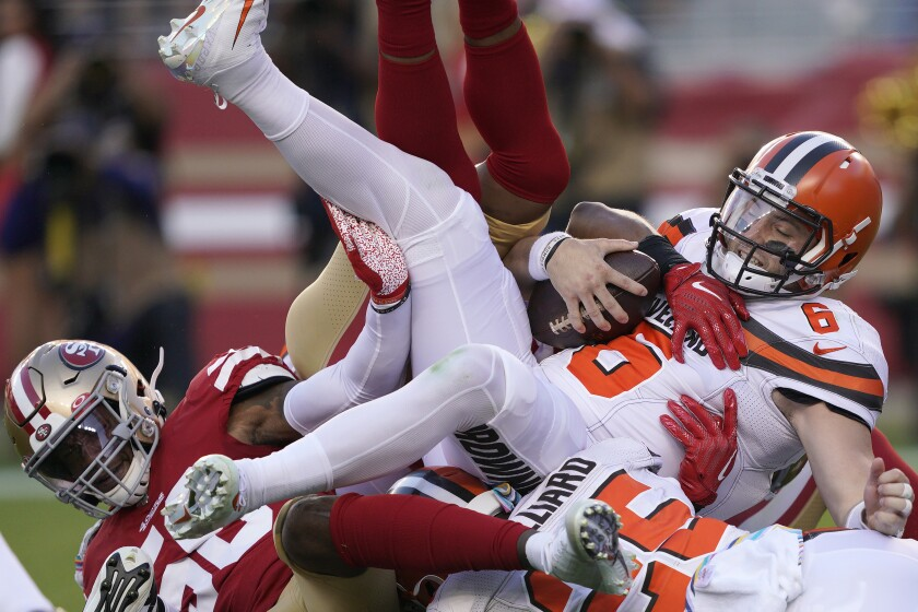 FILE - In this Oct. 7, 2019, file photo, Cleveland Browns quarterback Baker Mayfield (6) is sacked by San Francisco 49ers middle linebacker Kwon Alexander, left, and K'Waun Williams during the first half of an NFL football game in Santa Clara, Calif. The last time Baker Mayfield faced a talented, quarterback-seeking defensive line anchored by the No. 2 overall draft pick, things didn't go well. The San Francisco 49ers menaced and mauled Mayfield last season. On Sunday the Browns' QB faces Washington's ferocious front. (AP Photo/Tony Avelar, File)
