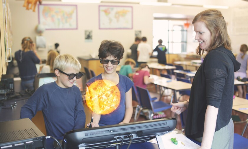 Students from Ross School District in Marin, Calif., use zSpace to learn about the sun.