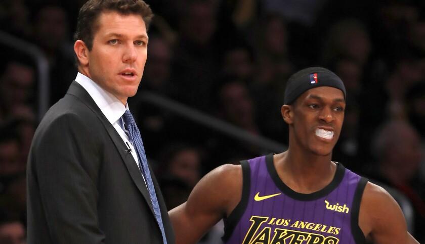 LOS ANGELES, CALIF. - NOV. 14, 2018. - Lakers head coach Luke Walton talks with guard Rajon Rondo in