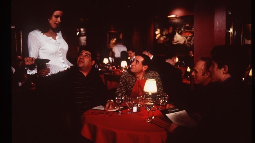 """Frank Pellegrino in center with Lorri Bagley and Vincent Pastore to his right and James Caan and Hugh Grant on his left in the romantic comedy """"Mickey Blue Eyes."""""""
