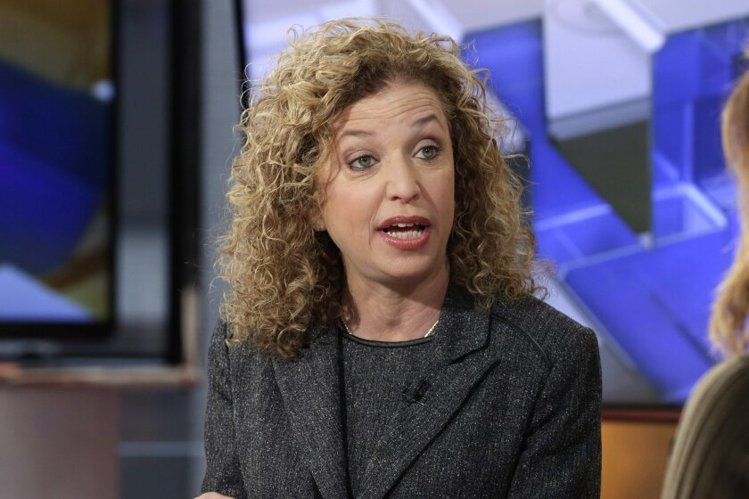 In this photo taken March 21, 2016, Democratic National Committee (DNC) Chair, Rep. Debbie Wasserman Schultz, D-Fla is interviewed in New York. Seeking to defuse tensions, the DNC said Friday, May 27, 2016, it will hold public hearings around the country to develop the platform for its summer conve